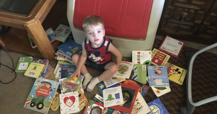 The little guy surrounded by books.