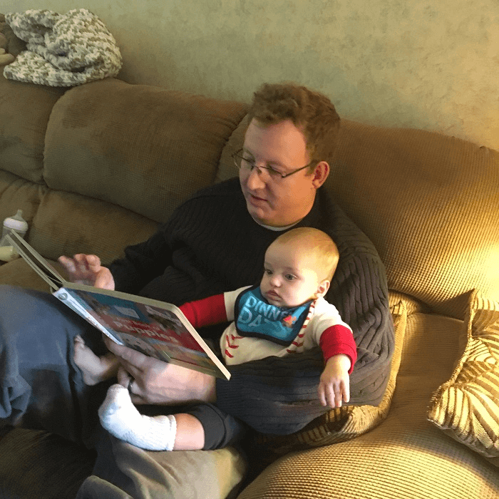 Reading to the little guy.